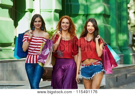 portrait of three sisters with Shopping Bags
