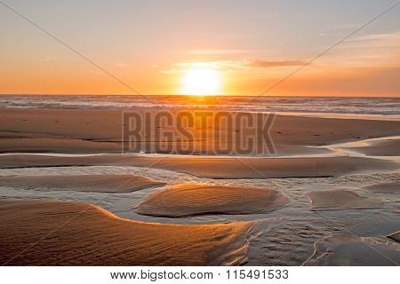 Sunset at Vale Figueiras beach in Portugal