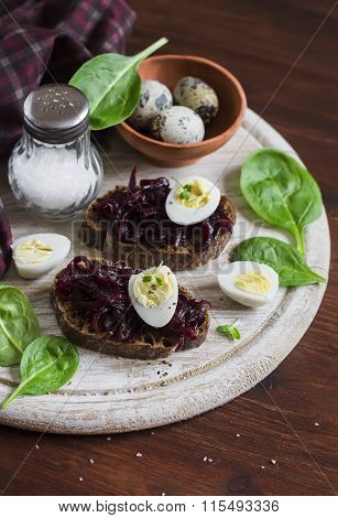 Beetroot Relish And A Sandwich With Beets, Quail Egg And Spinach On Rustic Light Wooden Board. Healt