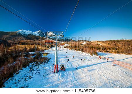 TATRANSKA LOMNICA, SLOVAKIA, 23 DEC 2015: Cable car at a popular ski resort in Tatranska Lomnica, High Tatras, with 6 km long dowhnill track.