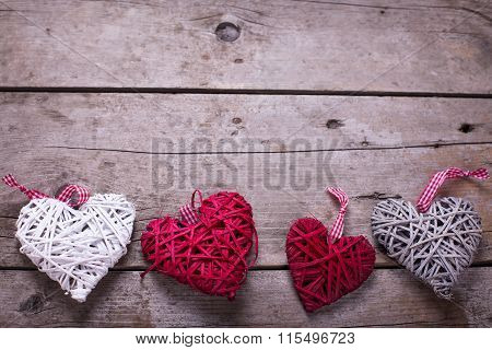 Red, White And Grey  Decorative  Hearts On  Aged  Wooden Background.