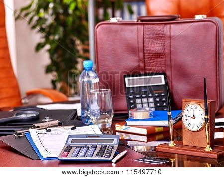 Business still life in interior on table and leather chair in office.