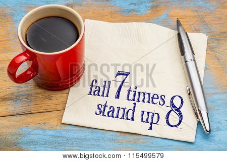 Fall seven times, stand up eight. Japanese proverb on napkin with a cup of coffee. Determination concept.