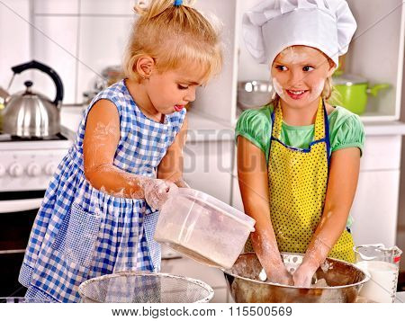 Alone kids preparing breakfast at home kitchen. Safety of children at home alone.