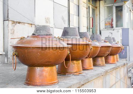 Row Of Traditional Chinese Hot Pots