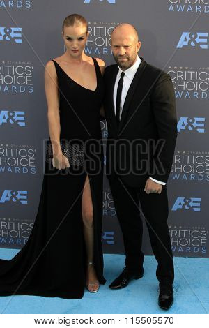 LOS ANGELES - JAN 17:  Rosie Huntington-Whiteley, Jason Statham at the 21st Annual Critics Choice Awards at the Barker Hanger on January 17, 2016 in Santa Monica, CA