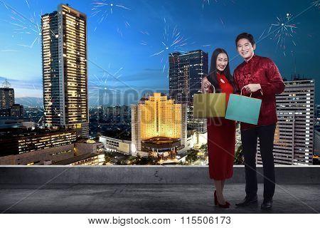 Chinese Couple Wear Cheongsam Holding Shopping Bag