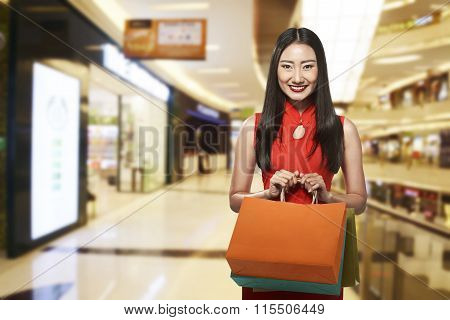 Chinese Woman In Cheongsam Dress Holding Shopping Bag