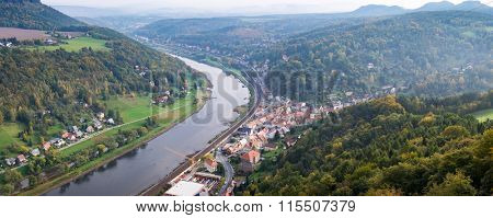View from viewpoint of Bastei in Saxon Switzerland Germany to the town city and the river Elbe in autumn. Low of sharpness because haze