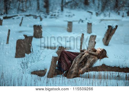 Girl Lay On A Tree And Freeze In Winter.