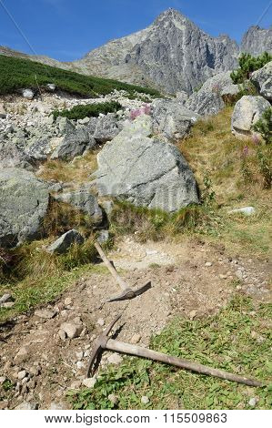 Old Pickaxes in rocky area in landscape aspect