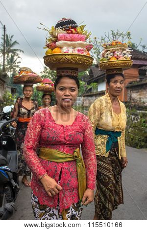 Bali, Indonesia - June 12, 2015:, Women carrying offerings for wedding June 12, 2015 on Bali, Indonesia