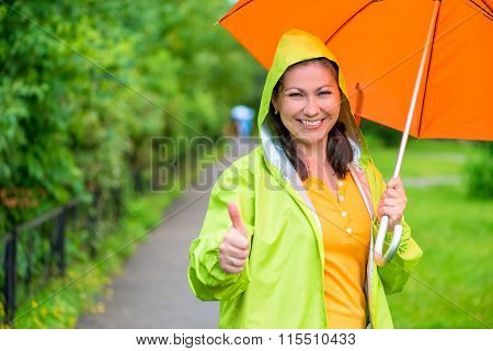 Happy Cute Girl Is Showing How She Likes Rain