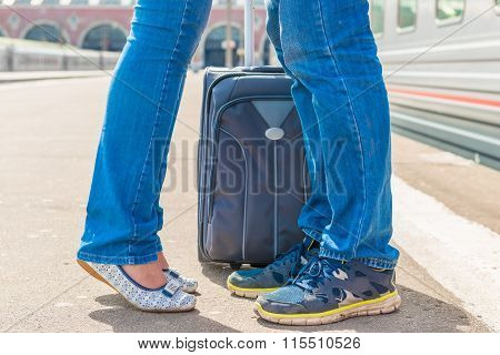 Feet Kissing Couple Near A Suitcase At The Railway Station Close-up