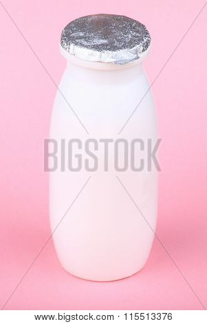 White Bottle On Pink Background