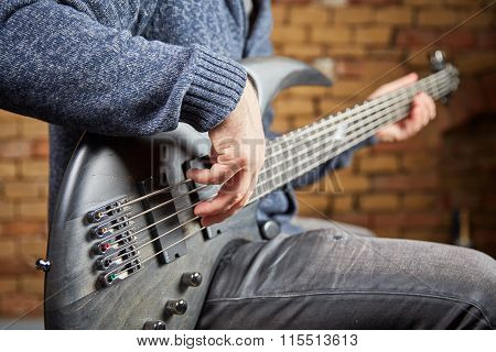 Bass Guitar Being Played In A Sound Studio