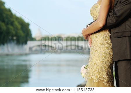 Bride And Groom In Wedding Day In Rome Near Tevere River