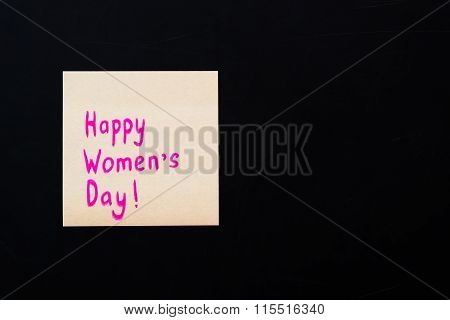 Happy Women's Day. Pink Sticker On Black Chalkboard