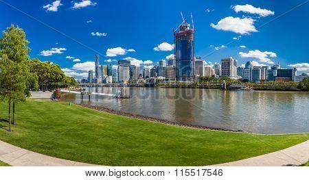 BRISBANE, AUS - NOV 18 2015: River walk in South Bank Parkland. It's inner-city man-made beach next to city center.