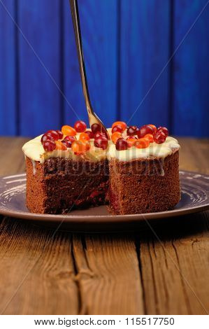 Chocolate Cake With Fresh Cranberries, Sea-buckthorn And Icing On Wooden Background