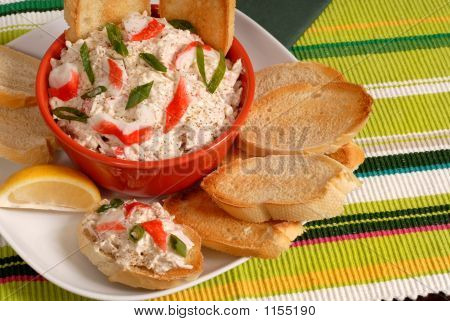 Bowl Of Crab Dip With Toasted Crostini And Lemon