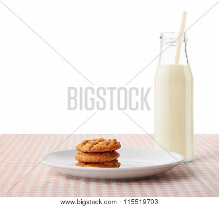Peanut Butter Cookies On White Plate And Bottle Of Milk