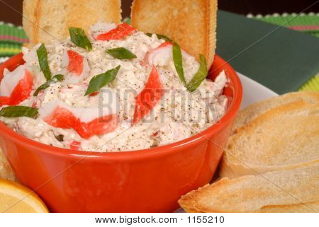Closeup Of A Bowl Of Crab Dip With Toasted Crostini And Lemon