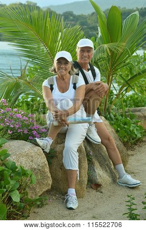 elderly couple rest at tropical resort