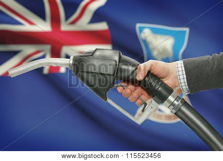 Fuel Pump Nozzle In Hand With National Flag On Background - Falkland Islands