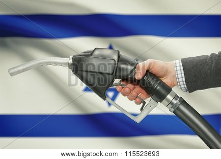 Fuel Pump Nozzle In Hand With National Flag On Background - Israel