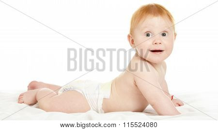 Adorable baby boy in pampers