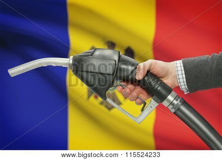 Fuel Pump Nozzle In Hand With National Flag On Background - Moldova