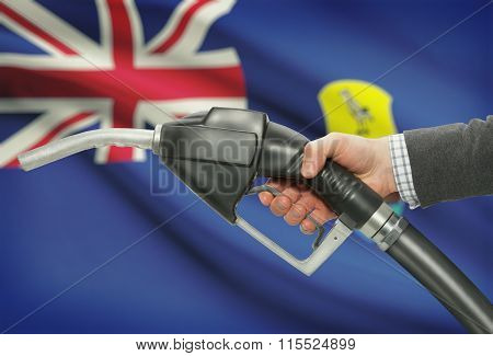 Fuel Pump Nozzle In Hand With National Flag On Background - Saint Helena