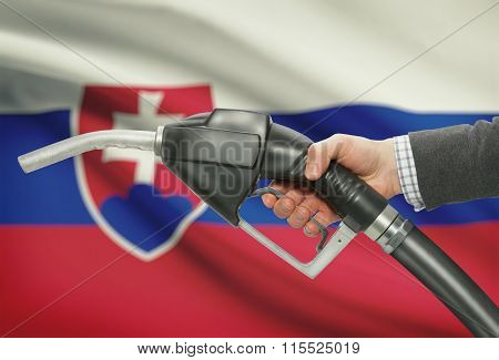 Fuel Pump Nozzle In Hand With National Flag On Background - Slovakia