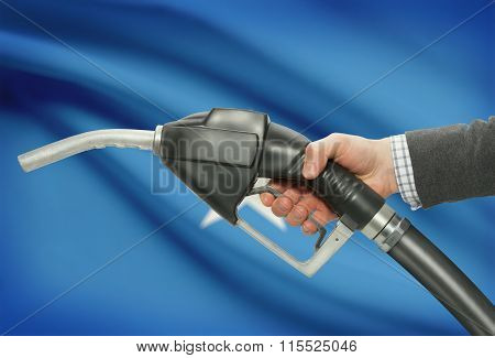 Fuel Pump Nozzle In Hand With National Flag On Background - Somalia