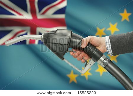 Fuel Pump Nozzle In Hand With National Flag On Background - Tuvalu