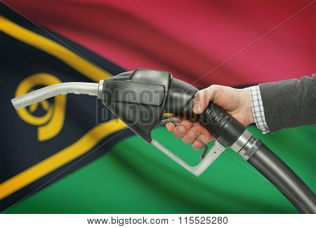 Fuel Pump Nozzle In Hand With National Flag On Background - Vanuatu