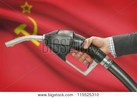 Fuel Pump Nozzle In Hand With National Flag On Background - Ussr - Soviet Union
