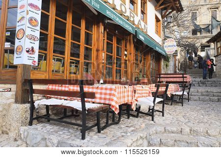 Mostar, Bosnia, January, 1, 2016: Landscape with the image of street cafe in Mostar, Bosnia