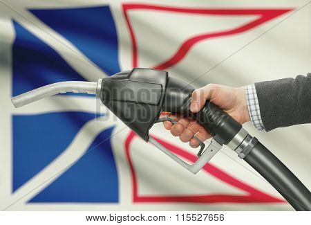 Fuel Pump Nozzle In Hand With Canadian Provinces Flags On Background - Newfoundland And Labrador