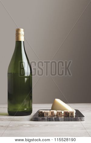 Wine Bottle With Cheese Side View