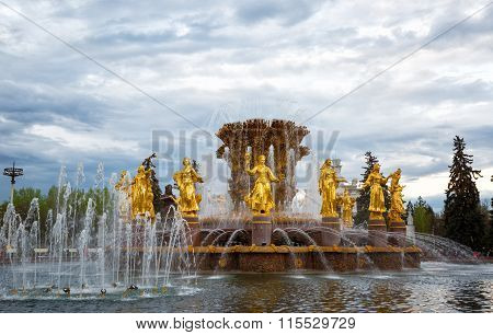 Fountain Friendship Of The People And The Central Pavilion On Vvc (vdnh) In Moscow, Russia