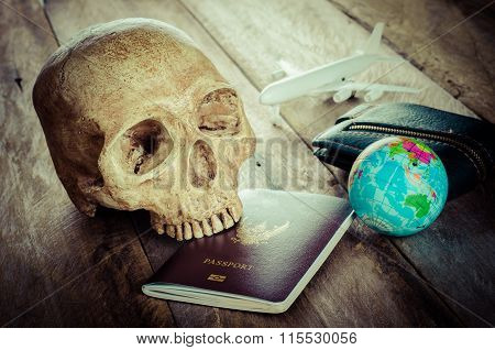 Skulls On The Passport On Wood Table - Concept Is Getting Dangerous. Do Not Be Careless