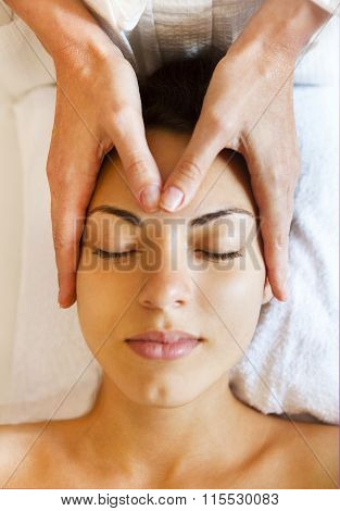Portrait Of A Young Woman Getting Spa Treatment. Face Massage