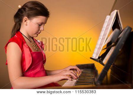 Piano Player. Girl Playing Piano.
