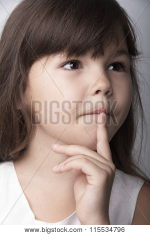 Portrait of a pensive little girl