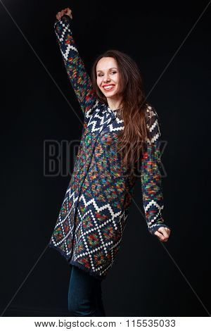 Young Brunette Woman In Bright Sweater Smiling