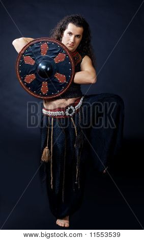 Man dance with buckler