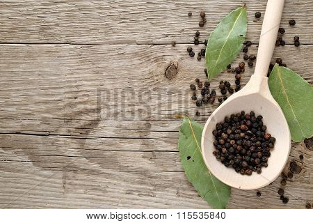 Black Pepper In Spoon On Wooden Table Top View
