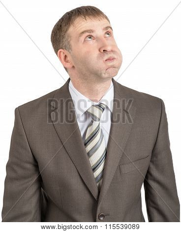 Businessman with inflated cheeks